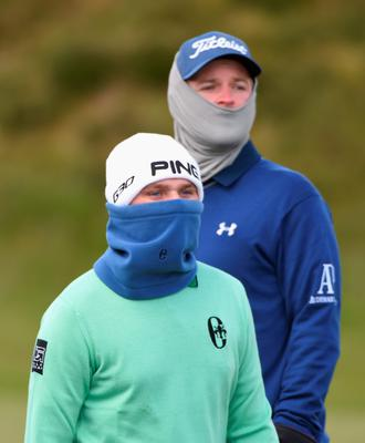 NEWCASTLE, NORTHERN IRELAND - MAY 29:  Bernd Wiesberger of Austria  (R) and Andy Sullivan of England look down the 13th hole during the Second Round of the Dubai Duty Free Irish Open Hosted by the Rory Foundation at Royal County Down Golf Club on May 29, 2015 in Newcastle, Northern Ireland.  (Photo by Ross Kinnaird/Getty Images)