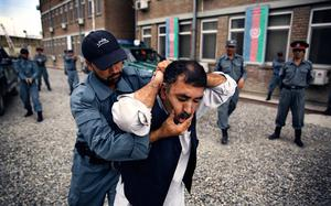 FIXATION YOUNG PHOTOGRAPHY BURSARY FINALIST Afghan National Police officers from the Anti-Narcotics Quick Reaction Force (ANQRF) carry out a brutal stop and search scenario exercise intended for drug traffickers at a training centre in Kabul. Picture: Souvid Datta