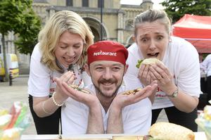 Belfast chef Robert McMahon pictured with Katie Kinnes and Jackie Stocks sampling some of the fine delights