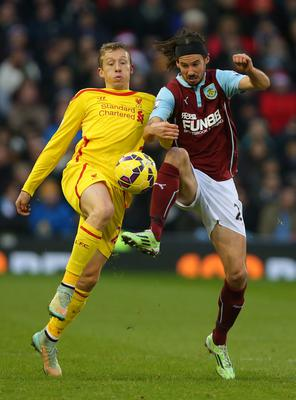 Liverpool's Lucas Leiva challenges Burnley's George Boyd during the Barclays Premier League match at Turf Moor, Burnley. Dave Thompson/PA Wire.