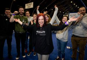 Returned Green Party MLA Clare Bailey (centre) celebrates with supporters at the Titanic Exhibition Centre, Belfast at the Northern Ireland Assembly election count. PA
