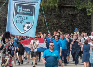 Football teams arrive in Guildhall Square in Derry-Londonderry after a city centre parade at the start of the Hughes Insurance Foyle Cup.  The annual tournament will see 2000 players from 310 teams playing over 1000 games across the North West. Picture Martin McKeown. Inpresspics.com. 19.07.16
