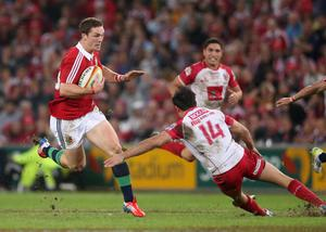 BRISBANE, AUSTRALIA - JUNE 08:  George North of the Lions moves past Rod Davies during the match between the Queensland Reds and the British & Irish Lions at Suncorp Stadium on June 8, 2013 in Brisbane, Australia.  (Photo by David Rogers/Getty Images)