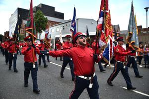 BELFAST, NORTHERN IRELAND - JULY 12:  Members of the Orange Order and their supporters take part in the Twelfth of July parade on July 12, 2019 in Belfast, Northern Ireland. Orangemen march annually on July 12th to commemorate the Protestant King William III's victory over the Catholic King James II at the Battle of the Boyne in 1690. (Photo by Charles McQuillan/Getty Images)