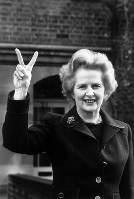 FILE - APRIL 8: Lord Bell, spokesperson for Baroness Margaret Thatcher, announced in a statement that the former British Prime Minister died peacefully following a stroke aged 87.   November 1976:  Conservative party leader Margaret Thatcher makes a 'victory' sign outside her home in Chelsea, London.  (Photo by John Minihan/Evening Standard/Getty Images)