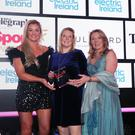 Clare McAllister, Residential Manager, Electric Ireland and Leah McCourt make a presentation to Gail Redmond. Photo by Kelvin Boyes / Press Eye.