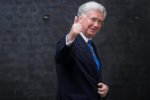 LONDON, ENGLAND - JULY 13: Newly appointed Defence Secretary Michael Fallon gives a thumbs up as he leaves Downing Street on July 13, 2016 in London, England. The UK's New Prime Minister  Theresa May began appointing the key Ministerial positions in her cabinet shortly after taking up residence at Number 10 Downing Street. She has appointed Philip Hammond as Chancellor and George Osborne has resigned. (Photo by Carl Court/Getty Images)