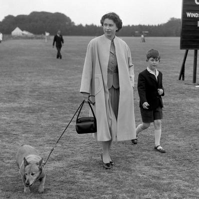 File photo dated 02/06/56 of Queen Elizabeth II walking through Windsor Great Park with Prince Charles to watch the Duke of Edinburgh play polo as she turns 90 on the April 21st. PRESS ASSOCIATION Photo. Issue date: Sunday April 3, 2016. See PA story ROYAL Birthday. Photo credit should read: PA Wire
