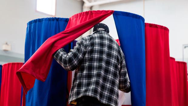 NASHUA, NH - NOVEMBER 8: New Hampshire citizens cast their vote at Amherst Street Elementary School on November 8, 2016, in Nashua, New Hampshire. Americans today will choose between Republican presidential candidate Donald Trump and Democratic presidential candidate Hillary Clinton as they go to the polls to vote for the next president of the United States. (Photo by Kayana Szymczak/Getty Images)