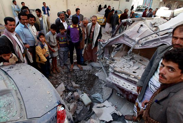Yemenis look at destruction in the street following air strikes on the capital, Sanaa, on January 5, 2016. AFP PHOTO / MOHAMMED HUWAISMOHAMMED HUWAIS/AFP/Getty Images