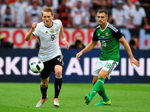 PARIS, FRANCE - JUNE 21: Aaron Hughes (R) of Northern Ireland and Andre Schurrle (L) of Germany during the UEFA EURO 2016 Group C match between Northern Ireland and Germany at Parc des Princes on June 21, 2016 in Paris, France. (Photo by Charles McQuillan/Getty Images)