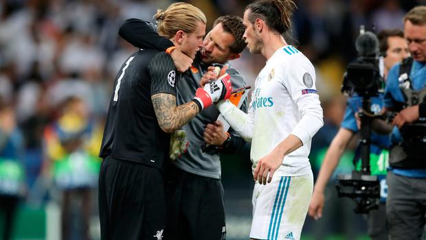 Liverpool goalkeeper Loris Karius is consoled by Liverpool goalkeeping coach John Achterberg (centre) and Real Madrid's Gareth Bale after the UEFA Champions League Final at the NSK Olimpiyskiy Stadium, Kiev. Nick Potts/PA Wire