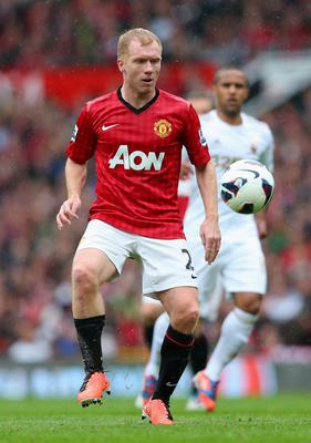MANCHESTER, ENGLAND - MAY 12:  Paul Scholes of Manchester United in action during the Barclays Premier League match between Manchester United and Swansea City at Old Trafford on May 12, 2013 in Manchester, England.  (Photo by Alex Livesey/Getty Images)