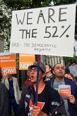 Pro-Brexit supporters holds up placards as they demonstrate outside Downing street in central London on July 13, 2016, on the day new British Prime Minister Theresa May takes over at number 10. Theresa May took office as Britain's second female prime minister on July 13 charged with guiding the UK out of the European Union after a deeply devisive referendum campaign ended with Britain voting to leave and David Cameron resigning. / AFP PHOTO / NIKLAS HALLE'NNIKLAS HALLE'N/AFP/Getty Images