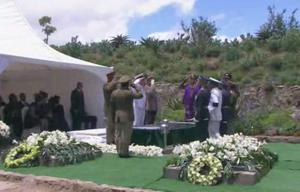 This frame grab from AP Television and SABC shows pallbearers saluting after the casket of former South African president Nelson Mandela was lowered during his funeral service Sunday, Dec. 15, 2013, in Qunu, South Africa. (AP Photo/SABC, Pool)