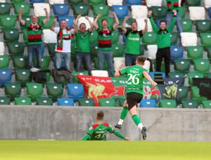 PACEMAKER PRESS BELFAST  31/7/2020  Glentoran's Paul O'Neill celebrates with the fans after scoring the opening goal against Ballymena United in the  Irish Cup Final at the National Stadium, Belfast tonight. PICTURE BY STEPHEN DAVISON