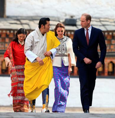 THIMPHU, BHUTAN - APRIL 14:  Prince William, Duke of Cambridge walks with His Majesty King Jigme Khesar Namgyel Wangchuck follwed by Catherine, Duchess of Cambridge and Her Majesty Jetsun Pema Wangchuck into the Tashichhodzong (fortress) on the first day of a two day visit to Bhutan on the 14th April 2016 in Paro, Bhutan. The Royal couple are visiting Bhutan as part of a week long visit to India and Bhutan that has taken in cities such as Mumbai, Delhi, Kaziranga, Bhutan and Agra.  (Photo by Chris Jackson/Getty Images)