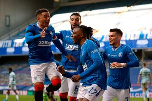 Rangers' Joe Aribo celebrates what proved to be the winning goal - an own goal by Callum McGregor.