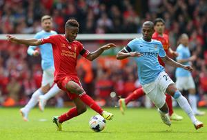 Raheem Sterling of Liverpool competes with Fernandinho of Manchester City during the Barclays Premier League match between Liverpool and Manchester City at Anfield on April 13, 2014 in Liverpool, England.  (Photo by Alex Livesey/Getty Images)
