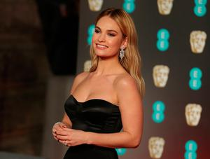 British actress Lily James poses on the red carpet upon arrival at the BAFTA British Academy Film Awards at the Royal Albert Hall in London on February 18, 2018. / AFP PHOTO / Daniel LEAL-OLIVASDANIEL LEAL-OLIVAS/AFP/Getty Images