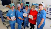 Heartfelt tribute: from left, Susan England, Jackie McKeown, Siobhan McArdle, Pamela Johnston, Claire Nicholl and Christine Taylor with the cookbook they created in memory of John Hinds