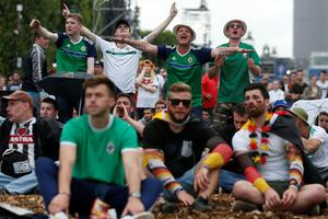 Northern Ireland fans react as they watch the Euro 2016 group C football match between Northern Ireland and Germany at the fan zone near the Eiffel Tower in Paris on June 21, 2016.   / AFP PHOTO / THOMAS SAMSONTHOMAS SAMSON/AFP/Getty Images
