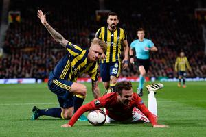 Manchester United's Spanish midfielder Juan Mata (R) is fouled in the area by Fenerbahce's Danish defender Simon Kjaer (L) to concede Manchester United's first penalty leading their first goal during the UEFA Europa League group A football match between Manchester United and Fenerbahce at Old Trafford in Manchester, north west England, on October 20, 2016. / AFP PHOTO / OLI SCARFFOLI SCARFF/AFP/Getty Images