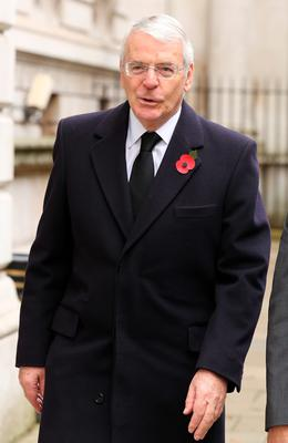 Former Prime Minister Sir John Major walks through Downing Street on his way to the annual Remembrance Sunday service at the Cenotaph memorial in Whitehall. Chris Radburn/PA Wire.