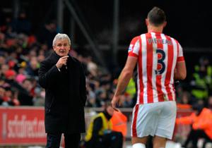 Stoke City manager Mark Hughes (left) gives instructions out from the touchline during the Barclays Premier League match at the Britannia Stadium, Stoke.