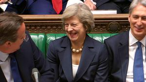 """Britain's out-going Prime Minister David Cameron (L) speaks at the dispatch box with new leader of the Conservative Party and incoming prime minister Theresa May (C) and British Foreign Secretary Philip Hammond (R) on the front bench during his last Prime Minister's Questions at the House of Commons in central London on July 13, 2016. Theresa May becomes Britain's second female prime minister on July 13, taking over from David Cameron whose career was ended by the seismic Brexit referendum, with the daunting task of leading the country out of the EU. Cameron, who has been premier for six years, will say his goodbyes at his last question-and-answer session in parliament before tendering his resignation to Queen Elizabeth II at Buckingham Palace.  / AFP PHOTO / PRU AND AFP PHOTO / PRU / RESTRICTED TO EDITORIAL USE - MANDATORY CREDIT """" AFP PHOTO / PRU """" - NO MARKETING NO ADVERTISING CAMPAIGNS - NO RESALE - NO DISTRIBUTION TO THIRD PARTIES - 24 HOURS USE - NO ARCHIVESPRU/AFP/Getty Images"""