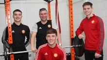 Portadown manager Matthew Tipton with his 19-year-old captain Luke Wilson (right), midfielder and son George (left) and 25-year-old 'old head' Paddy McNally (front).