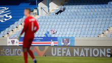 Redundant: A solitary and rather unnecessary steward watches the Nations League tie between Iceland and England in Reykjavik
