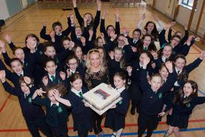 Pupils from St Patrick's Primary School, Pennyburn in Derry who are celebrating with their teacher Ursula Cullen after the won the BBC  Junior School Choir of the Year 2013. Picture Martin McKeown
