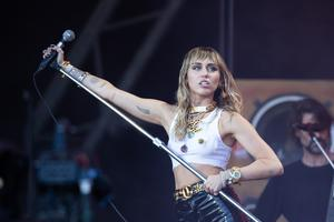 Miley Cyrus was booked to perform (Aaron Chown/PA)