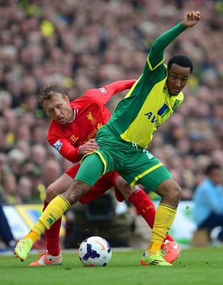 NORWICH, ENGLAND - APRIL 20:  Nathan Redmond of Norwich City and Lucas Leiva of Liverpool compete for the ball during the Barclays Premier League match between Norwich City and Liverpool at Carrow Road on April 20, 2014 in Norwich, England.  (Photo by Jamie McDonald/Getty Images)