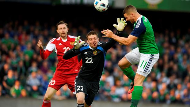BELFAST, NORTHERN IRELAND - MAY 27: Conor Washington (R) of Northern Ireland scores during the international friendly game between Northern Ireland and Belarus on May 26, 2016 in Belfast, Northern Ireland. (Photo by Charles McQuillan/Getty Images)