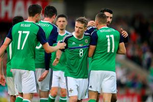 Northern Ireland's Conor Washington (11) celebrates with his team-mates after scoring his side's second goal during the International Friendly at Windsor Park, Belfast. PRESS ASSOCIATION Photo. Picture date: Friday May 27, 2016. See PA story SOCCER N Ireland. Photo credit should read: Niall Carson/PA Wire. RESTRICTIONS: Editorial use only, No commercial use without prior permission, please contact PA Images for further information: Tel: +44 (0) 115 8447447.