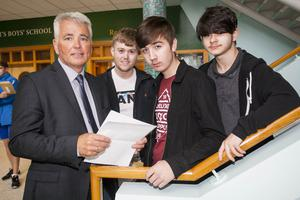 St. Joseph's Boys School, Derry Principal, Mr. Damian Harkin pictured with A Level students Jake Allen Darragh Stillman and Shaunie McLaughlin after receiving their results at the school yesterday morning.