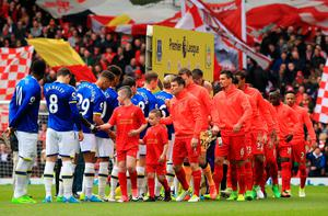"""Liverpool and Everton players shake hands before the Premier League match at Anfield, Liverpool. PRESS ASSOCIATION Photo. Picture date: Saturday April 1, 2017. See PA story SOCCER Liverpool. Photo credit should read: Peter Byrne/PA Wire. RESTRICTIONS: EDITORIAL USE ONLY No use with unauthorised audio, video, data, fixture lists, club/league logos or """"live"""" services. Online in-match use limited to 75 images, no video emulation. No use in betting, games or single club/league/player publications."""