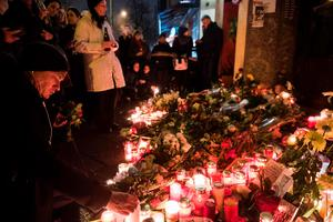 A man lights a candle during a wake outside British music legend David Bowie's former home in Berlin's Hauptstrasse 155 late on January 11, 2016.    British music legend David Bowie has died at the age of 69 after a secret battle with cancer, prompting a cascade of tributes for one of the most influential and innovative artists of his time.  / AFP / ODD ANDERSENODD ANDERSEN/AFP/Getty Images