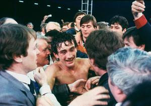 LONDON - JUNE 8 : Barry McGuigan of Northern Ireland celebrates after beating WBA Champion Eusebio Pedroza of Panama at Loftus Road Stadium,London on the 8th of June 1985. Barry McGuigan won by a points decision after 15 rounds to become the new WBA Champion of the world.