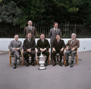 (FILE PHOTO) British Film Actor And Director Lord Richard Attenborough Dies Aged 90 1970:  The directors of Chelsea Football Club, including film director and actor Richard Attenborough (seated left) and Dave Sexton (standing right), with the FA Cup trophy.  (Photo by A. Jones/Express/Getty Images)