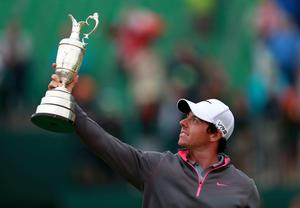 Northern Ireland's Rory McIlroy celebrates with the Claret Jug after winning the 2014 Open Championship at Royal Liverpool Golf Club, Hoylake.