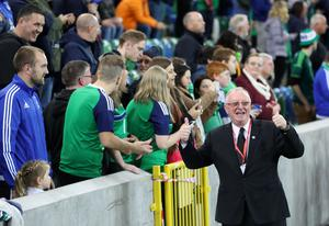 Press Eye - Belfast -  Northern Ireland - 08th October 2016 - Photo by William Cherry  To mark the official opening of the National Stadium at Windsor Park, some famous Northern Ireland faces from sport, tv and music to do a lap of the pitch before Northern Ireland took on San Marino in the World Cup 2018 Qualifier. Pictured with the fans is Denis Taylor
