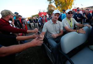 Europe's Justin Rose and Europe vice captain Padraig Harrington (right) on a buggy after the Fourballs on day two of the 41st Ryder Cup at Hazeltine National Golf Club in Chaska, Minnesota, USA. David Davies/PA Wire.