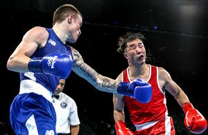 Packing some punch: Steven Donnelly (left) delivers a hefty blow to Mongolia's Tuvshinbat Byamba