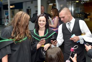 Ulster University Graduations-Coleraine Capmpus-05-07-15 Checking out those photographs. Photo by Simon Graham/Harrison Photography