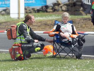 PACEMAKER, BELFAST, 15/5/2014: Maria Costello is treated by Dr John Hinds after crashing during the final qualifying session for the Vauxhall International North West 200 today. PICTURE BY STEPHEN DAVISON