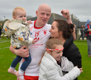 Winner: Lamh Dearg's Paddy Cunningham with partner Claire, children Aoife and Amy
