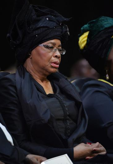 Nelson Mandelas widow Graca Machel listens to speakers during the funeral service for former South African President Nelson Mandela in Qunu, South Africa, Sunday, December 15, 2013. (AP Photo/Odd Andersen, Pool)